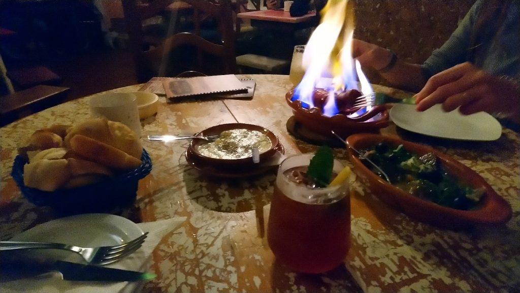Flaming sausage in Adega Bar in Ericeira
