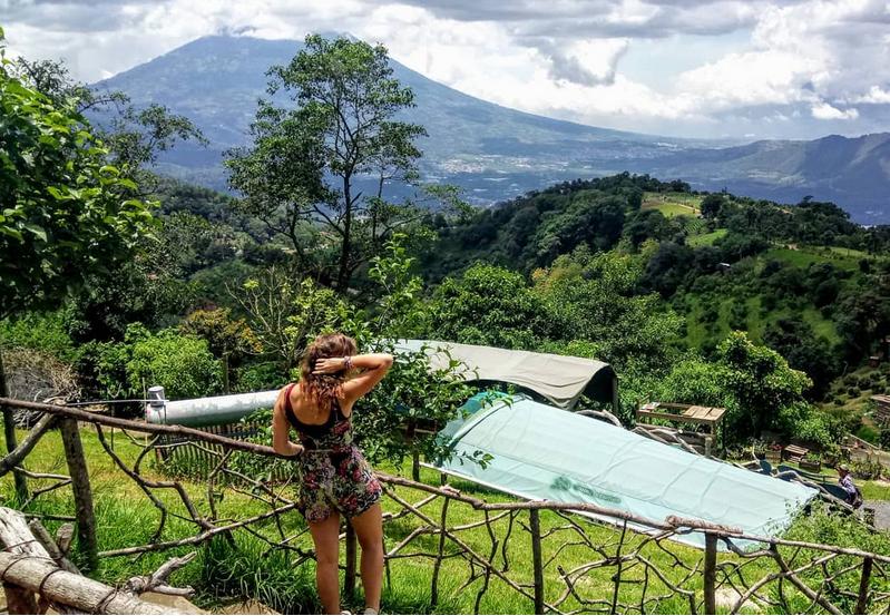 Looking over Guatemalan volcanoes in Hobbitenango