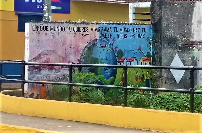 "Graffiti in Granada, Nicaragua which reads ""Which of these two worlds do you want to live in? If you love the world, do your part"""