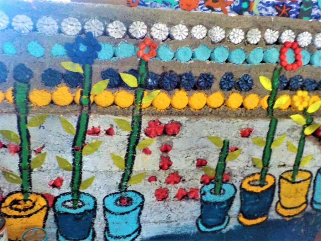 A wall built by the recycling intitiative in Ometepe Bilingual School in Nicaragua which is made from concrete and old plastic bottles filled with rubbish
