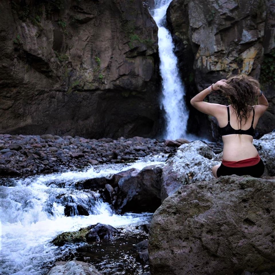 By a waterfall in Matagalpa in Nicaragua as part of my solo female backpacking adventure