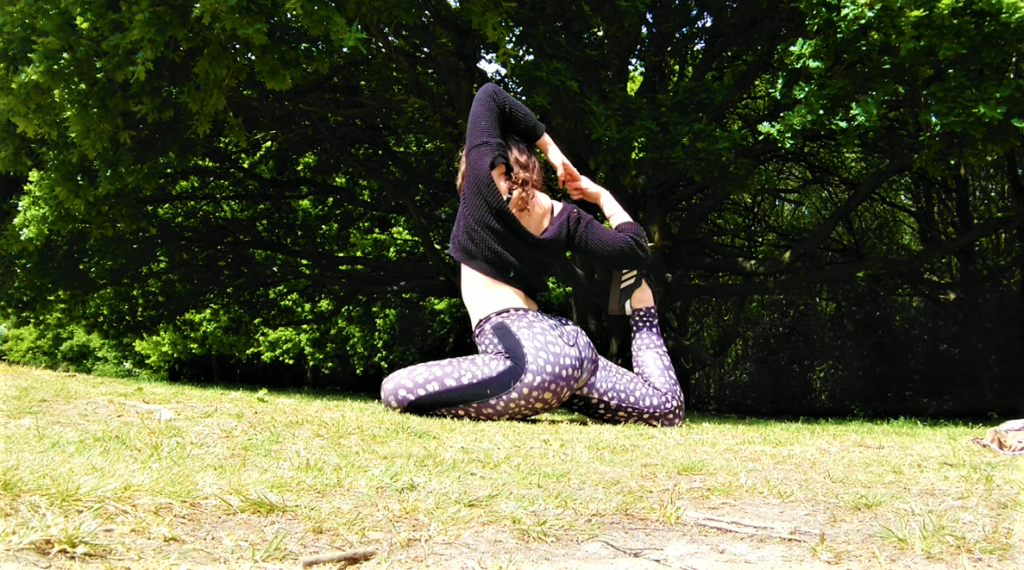 yoga pose in the forest